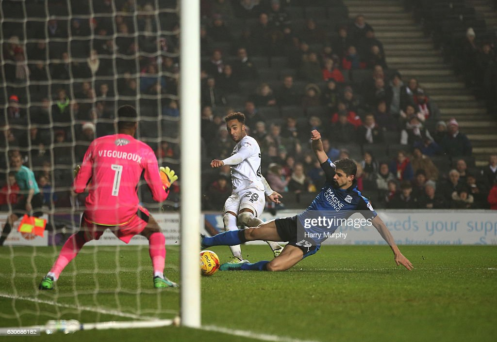 Nicky Maynard of Milton Keynes Dons scores his teams third during the Sky Bet League One match between Milton Keynes Dons and Swindon Town at StadiumMK on December 30, 2016 in Milton Keynes, England.