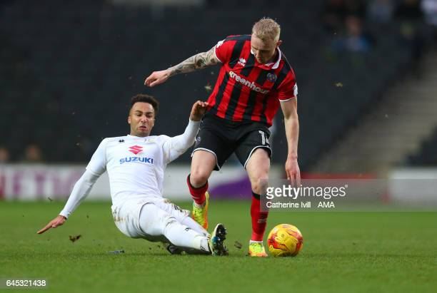 Nicky Maynard of MK Dons and Jack Grimmer of Shrewsbury Town during the Sky Bet League One match between MK Dons and Shrewsbury Town at StadiumMK on...