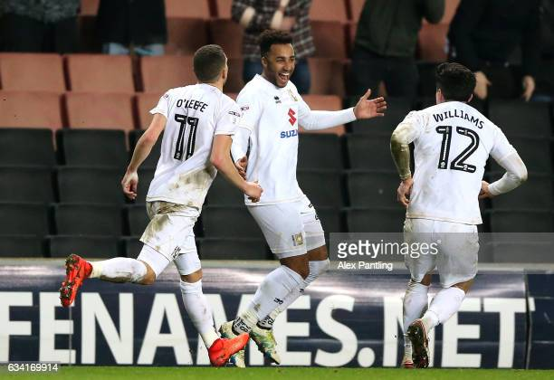 Nicky Maynard of MK Dons celebrates scoring his sides first goal with team mates during the Sky Bet League One match between Milton Keynes Dons and...