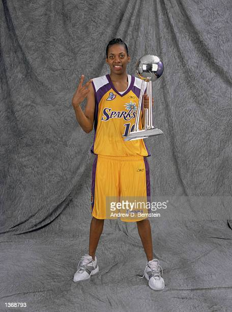 Nicky McCrimmon of the Los Angeles Sparks poses for a studio portrait with the WNBA Championship Trophy after winning the 2002 WNBA Finals against...