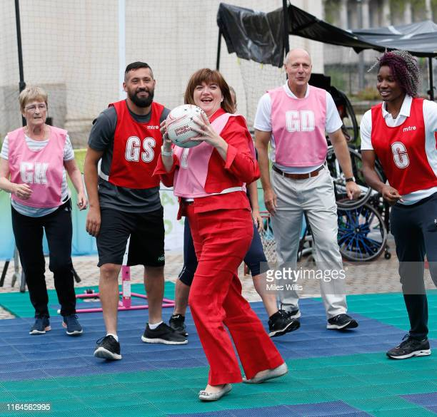 Nicky Morgan Secretary of State for Digital Culture Media and Sport plays netball during the Birmingham 2022 Commonwealth Games celebrates threeyear...