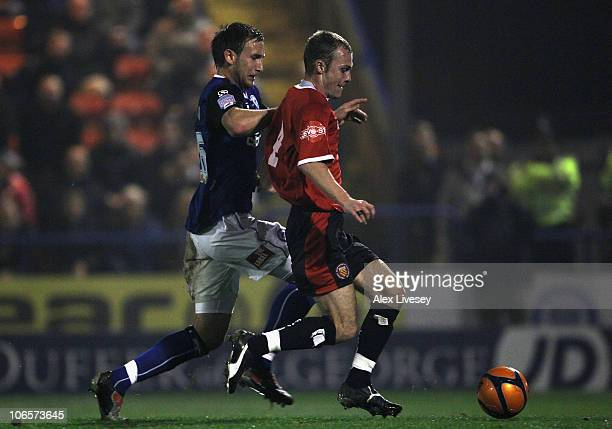 Nicky Platt of FC United of Manchester beats Craig Dawson of Rochdale to score the opening goal during the FA Cup 1st Round match sponsored by eon at...