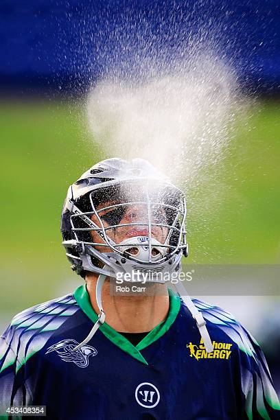 Nicky Polanco of the Chesapeake Bayhawks spits out water while warming up before the start of their game of against the Charlotte Hounds at...