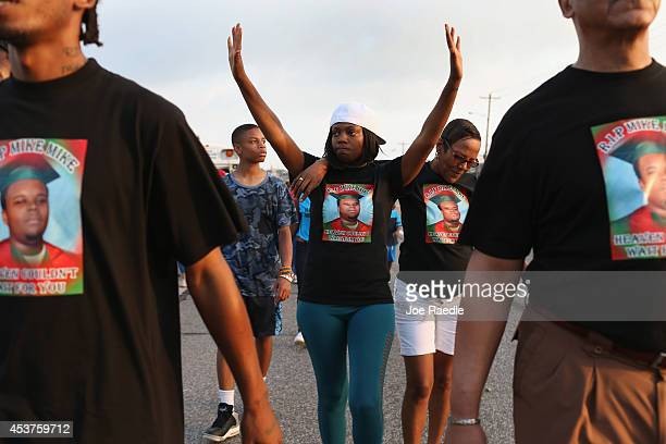 Nicky Rivers and her mother Alison McSpadden, the aunt of Michael Brown, make their voices heard as they walk through the streets on August 17, 2014...