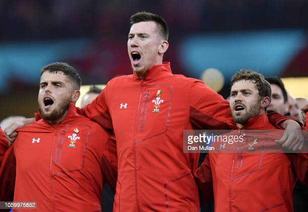 Nicky Smith Adam Beard and Leigh Halfpenny of Wales sing the national anthem prior to the International Friendly match between Wales and Australia at...