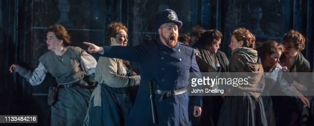 Nicky Spence as Sergent Johnny Strong performs on stage in a production of Iain Bell's Jack The Ripper by the English National Opera at London...