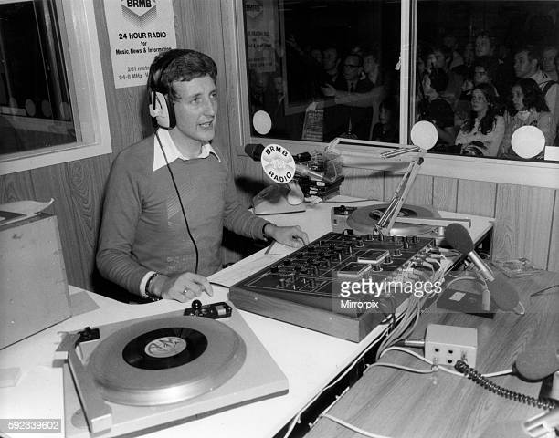 Nicky Steele BRMB Radio Presenter broadcasting his afternoon show live from the Motor Show at the National Exhibition Centre Birmingham Circa 1975