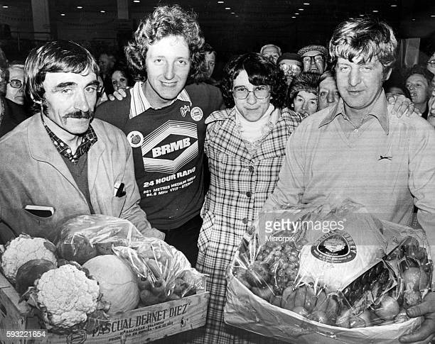 Nicky Steele BRMB Radio Presenter with Barbara Berry who was held at knife point and robbed Pictured receiving gifts from market traders Frank Ellis...