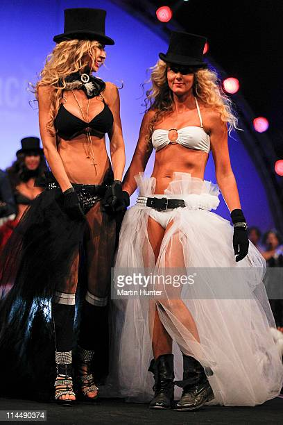 Nicky Watson and Sally Ridge walk the catwalk during the Rise Up Christchurch telethon appeal event at CBS Canterbury Arena on May 22 2011 in...