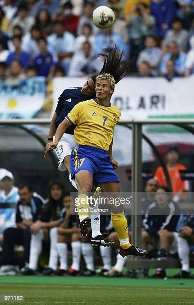 Niclas Alexandersson of Sweden clashes with Juan Sorin of Argentina during the Argentina v Sweden Group F World Cup Group Stage match played at the...