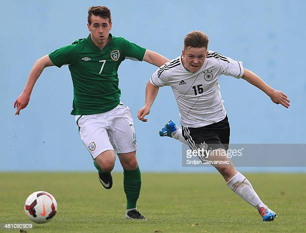 Niclas Bahn of Germany competes for the ball with Shane Elworthy of Ireland during the UEFA Under17 Elite Round between Germany and Ireland at...