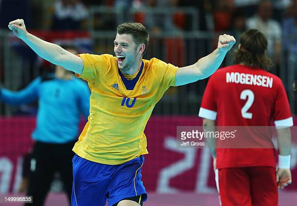 Niclas Ekberg of Sweden celebrates following his teams victory over Denmark during the Men's Quarterfinal match between Sweden and Denmark on Day 12...