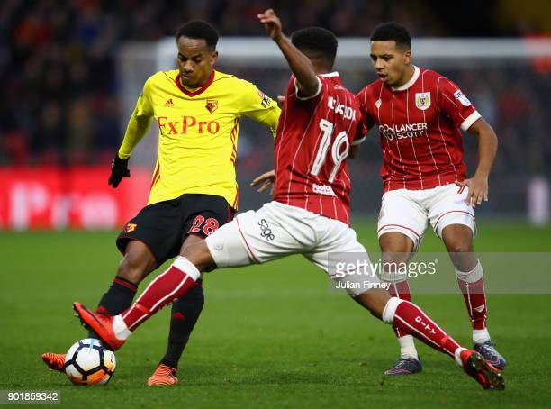Niclas Eliasson of Bristol City battles with Andre Carrillo of Watford during The Emirates FA Cup Third Round match between Watford and Bristol City...