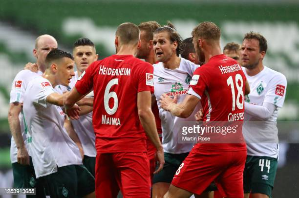 Niclas Füllkrug of Bremen gets involved in a heated discussion with players of Heidenheim during the Bundesliga playoff first leg match between...