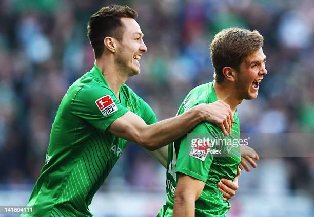 Niclas Fuellkrug of Bremen celebrates with his team mate Aleksandar Ignjovski after scoring his team's first goal during the Bundesliga match between...