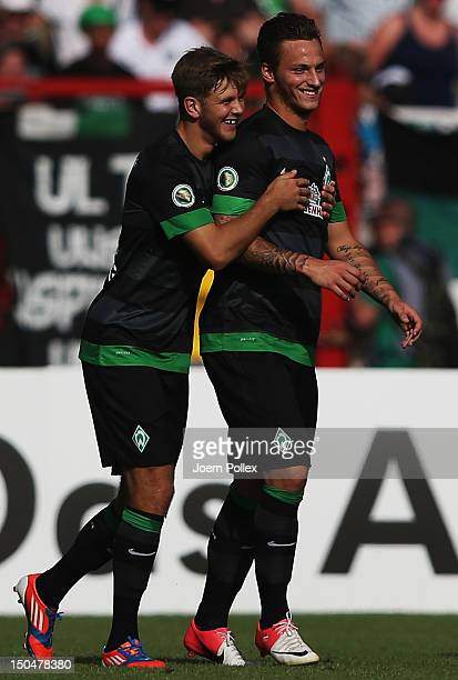 Niclas Fuellkrug of Bremen celebrates with his team mate Marko Arnautovic after scoring his team's second goal during the DFB Cup first round match...
