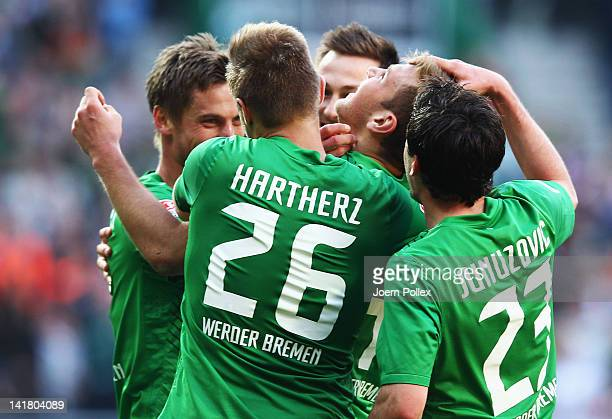 Niclas Fuellkrug of Bremen celebrates with his team mates after scoring his team's first goal during the Bundesliga match between SV Werder Bremen...