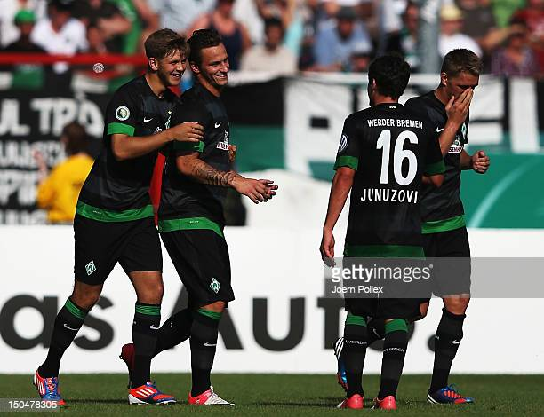 Niclas Fuellkrug of Bremen celebrates with his team mates after scoring his team's second goal during the DFB Cup first round match between Preussen...