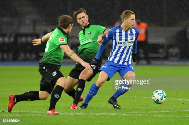 Niclas Fuellkrug of Hannover 96 and Arne Maier of Hertha BSC during the game between Hertha BSC and Hannover 96 on december 13 2017 in Berlin Germany