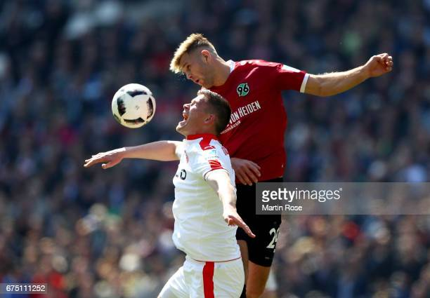 Niclas Fuellkrug of Hannover and Alexander Madlung of Duesseldorf battle for the ball during the Second Bundesliga match between Hannover 96 and...