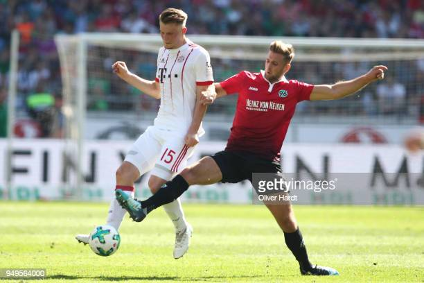 Niclas Fuellkrug of Hannover and Lars Lukas Mai of Munich compete for the ball during the Bundesliga match between Hannover 96 and FC Bayern Muenchen...