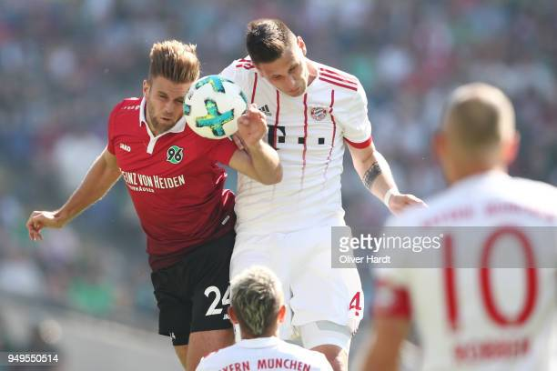 Niclas Fuellkrug of Hannover and Niklas Suele of Munich compete for the ball during the Bundesliga match between Hannover 96 and FC Bayern Muenchen...