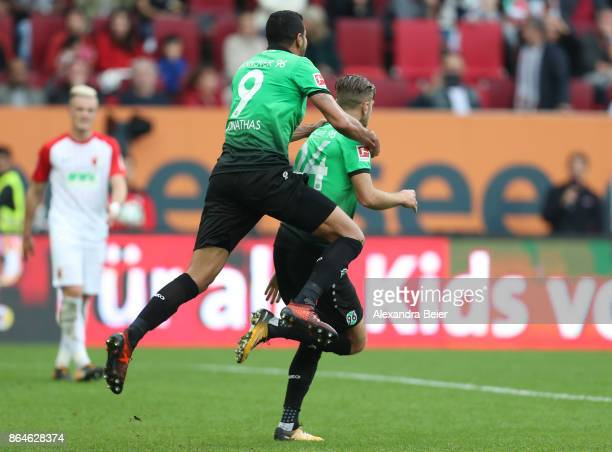 Niclas Fuellkrug of Hannover celebrates with Jonathas of Hannover after he scored a goal to make it 11 during the Bundesliga match between FC...