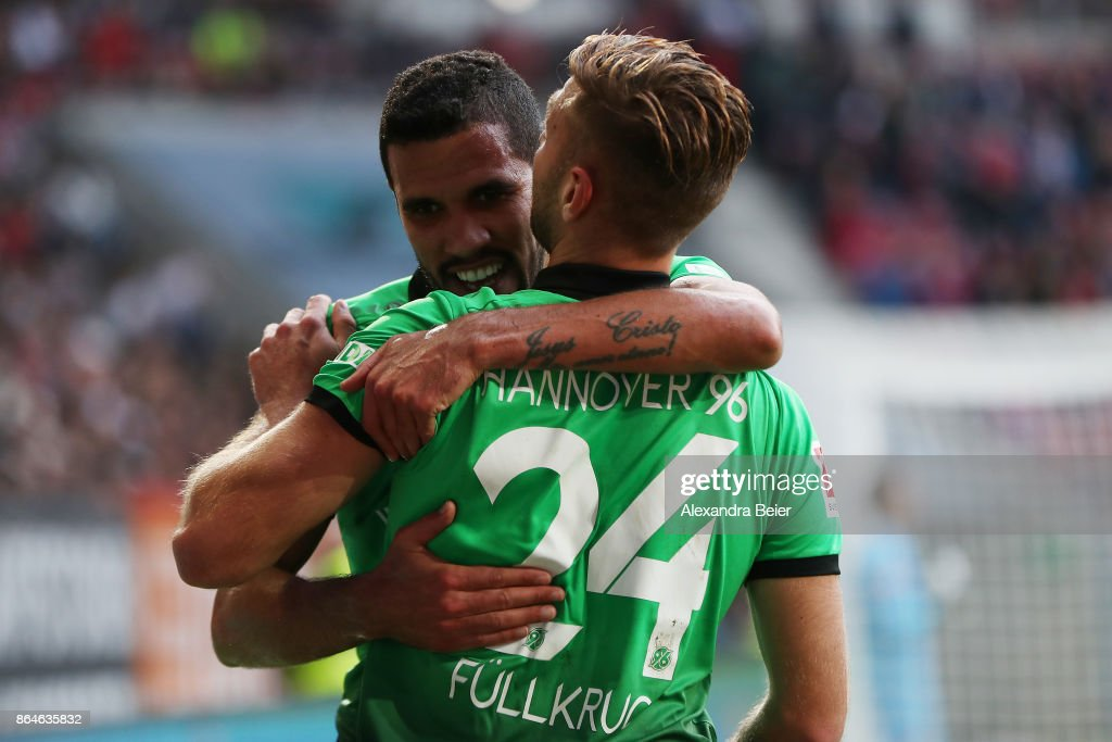 Niclas Fuellkrug of Hannover celebrates with Jonathas of Hannover after he scored the winning goal for Hannover to make it 1:2 during the Bundesliga match between FC Augsburg and Hannover 96 at WWK-Arena on October 21, 2017 in Augsburg, Germany.