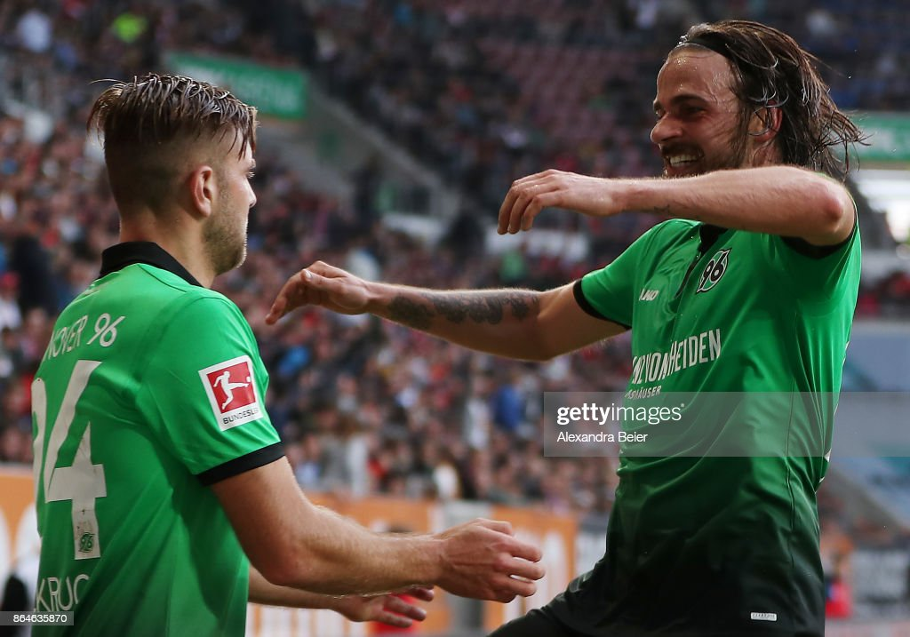 Niclas Fuellkrug of Hannover celebrates with Martin Harnik of Hannover (r) after he scored the winning goal for Hannover to make it 1:2 during the Bundesliga match between FC Augsburg and Hannover 96 at WWK-Arena on October 21, 2017 in Augsburg, Germany.