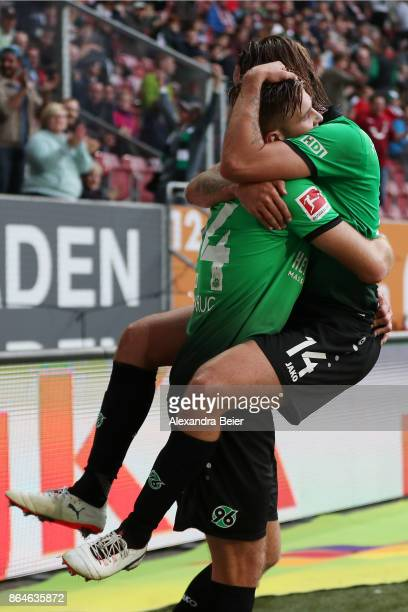 Niclas Fuellkrug of Hannover celebrates with Martin Harnik of Hannover after he scored the winning goal for Hannover to make it 12 during the...