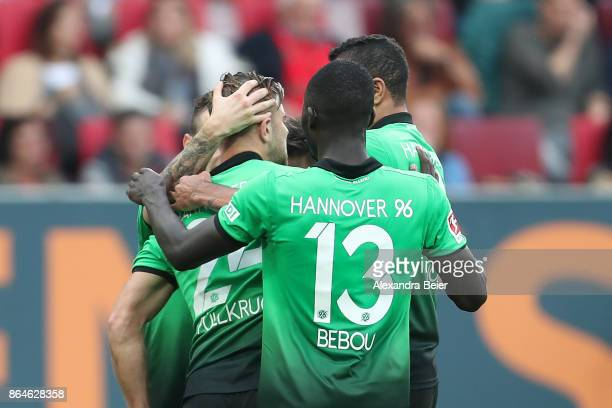 Niclas Fuellkrug of Hannover celebrates with team mates after he scored a goal to make it 11 during the Bundesliga match between FC Augsburg and...
