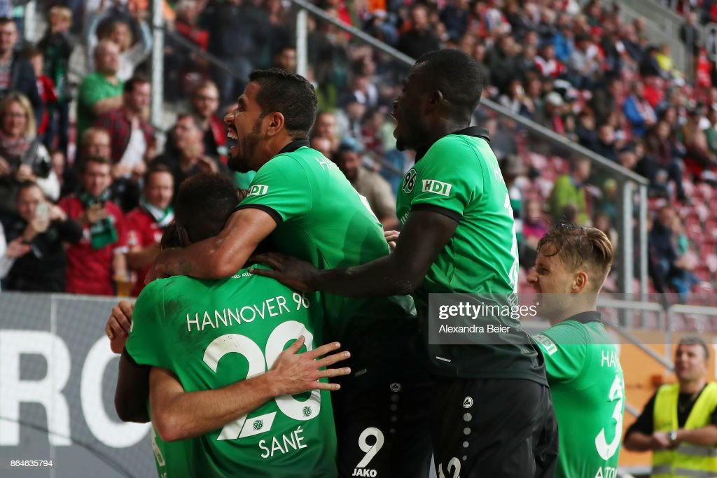 Niclas Fuellkrug of Hannover (not seen) celebrates with team mates after he scored the winning goal for Hannover to make it 1:2 during the Bundesliga match between FC Augsburg and Hannover 96 at WWK-Arena on October 21, 2017 in Augsburg, Germany.