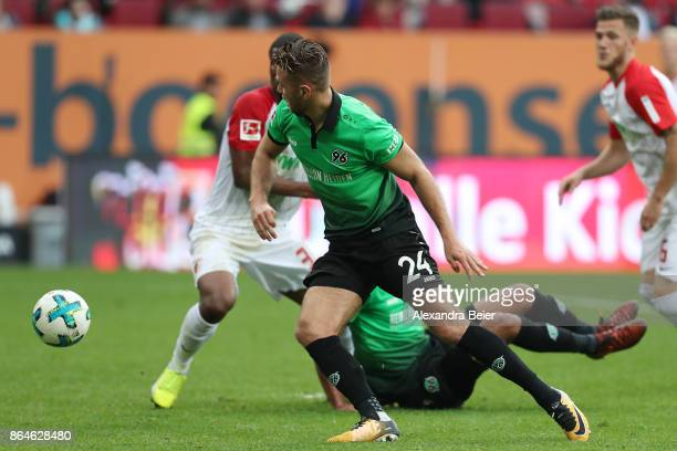 Niclas Fuellkrug of Hannover goes for the ball and scores a goal to make it 11 during the Bundesliga match between FC Augsburg and Hannover 96 at...