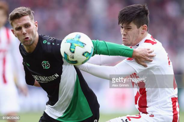Niclas Fuellkrug of Hannover is challenged by Jorge Mere of Koeln during the Bundesliga match between 1 FC Koeln and Hannover 96 at...