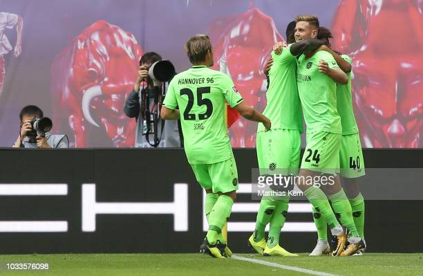 Niclas Fuellkrug of Hannover jubilates with team mates after scoring the second goal during the Bundesliga match between RB Leipzig and Hannover 96...