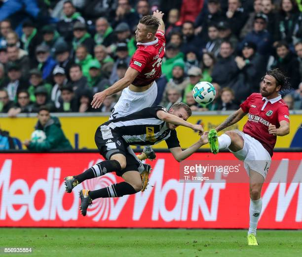 Niclas Fuellkrug of Hannover Martin Harnik of Hannover and Matthias Ginter of Moenchengladbach battle for the ball during the Bundesliga match...