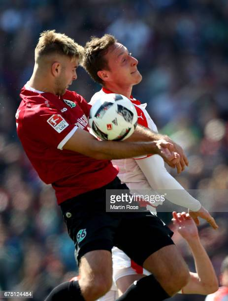 Niclas Fuellkrug of Hannover Robin Bormuth and of Duesseldorf head for the ball during the Second Bundesliga match between Hannover 96 and Fortuna...