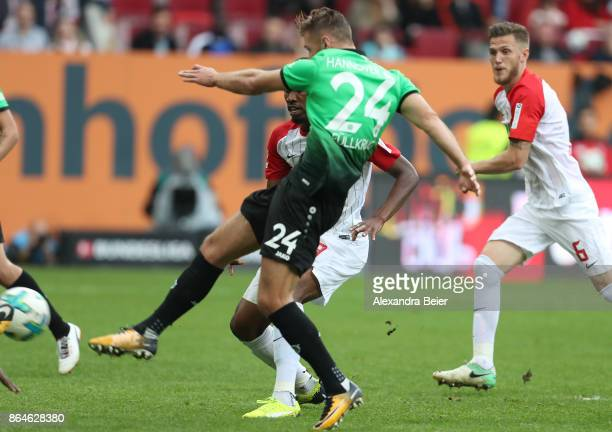 Niclas Fuellkrug of Hannover shoots on target and scores a goal to make it 11 during the Bundesliga match between FC Augsburg and Hannover 96 at...