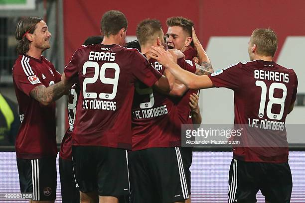 Niclas Fuellkrug of Nuernberg celebrates scoring the opening goal with his team mates during the Second Bundesliga match between 1 FC Nuernberg and...