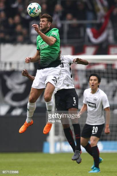 Niclas Fullkrug of Hannover 96 and Gelson Fernandes of Eintracht Frankfurt battle for the ball during the Bundesliga match between Eintracht...