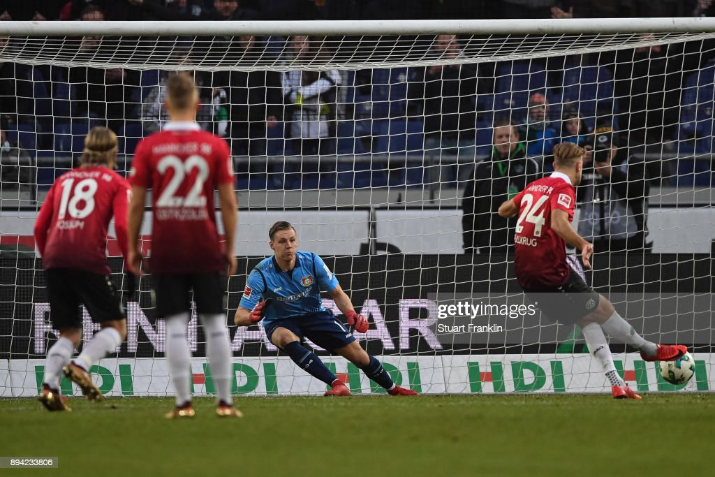 Niclas Fullkrug #24 of Hannover 96 scores from the penalty against Bernd Leno #1 of Bayer Leverkusen to make it 2-1 during the Bundesliga match between Hannover 96 and Bayer 04 Leverkusen at HDI-Arena on December 17, 2017 in Hanover, Germany.
