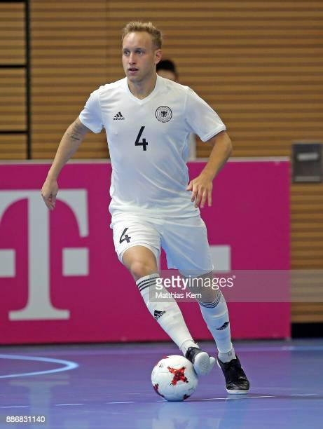 Niclas Hoffmans of Germany runs with the ball during the Futsal international friendly match between Germany and Czech Republic at Ballsport Arena on...