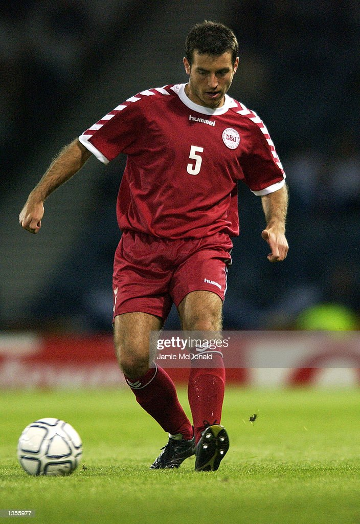Niclas Jensen of Denmark in action during the International Friendly between Scotland and Denmark at Hampden Park in Glasgow, Scotland on August 21, 2002.