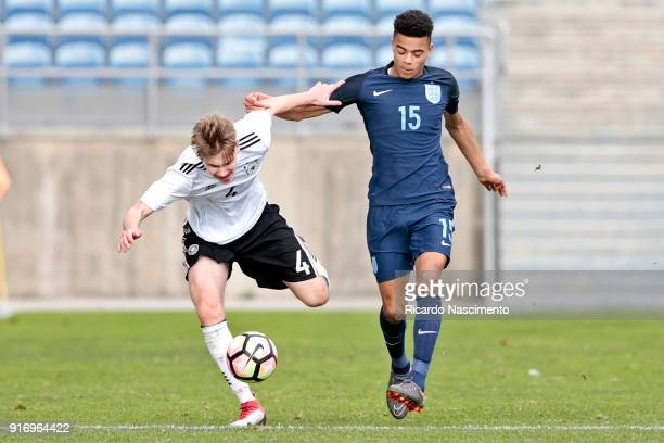 Niclas Knoop of Germany U17 chalenges Mason Greenwood of England U17 during U17Juniors Algarve Cup match between U17 Germany and U17 England at...