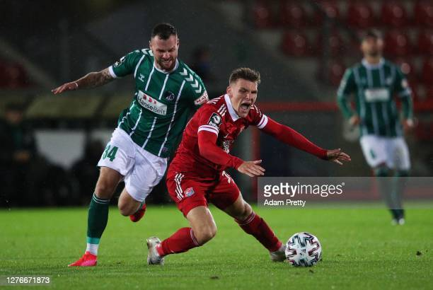 Niclas Stierlin of SpVgg Unterhaching is challenged by Patrick Hobsch of VfB Luebeck during the 3. Liga match between SpVgg Unterhaching and VfB...