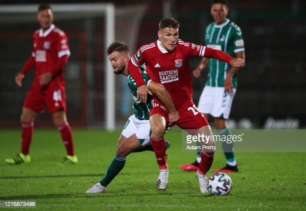 Niclas Stierlin of SpVgg Unterhaching is challenged by Yannick Deichmann of VfB Luebeck during the 3. Liga match between SpVgg Unterhaching and VfB...