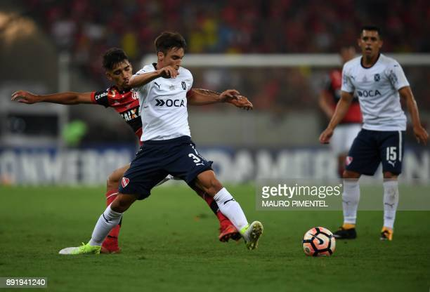 Niclas Tagliafico of Argentina's Independiente vies for the ball with Lucas Paqueta of Brazil's Flamengo during their Copa Sudamericana 2017 football...