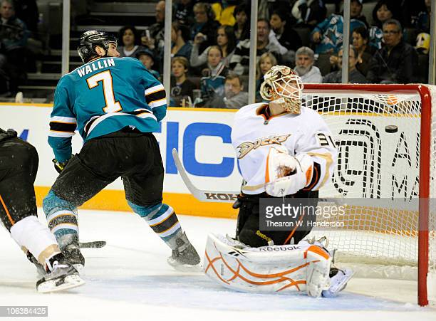 Niclas Wallin#7 of the San Jose Sharks watches his shot go in the net pass goalie Curtis McElhinney of the Anaheim Ducks during an NHL hockey game at...