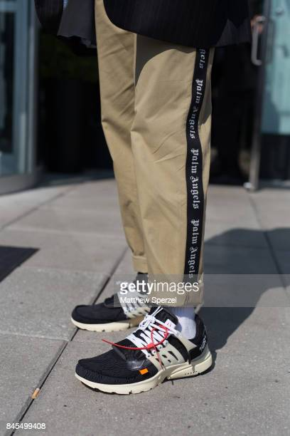 Nico Amarca is seen attending Public School during New York Fashion Week wearing Sita Abellan Palm Angels Armani Nike x Off White on September 10...