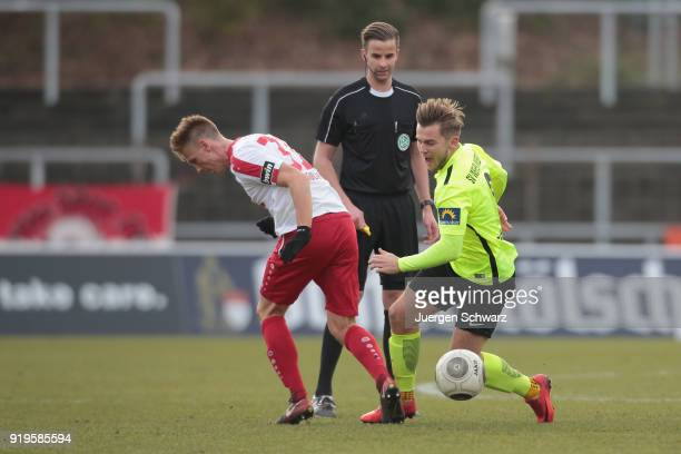 Nico Brandenburger of Cologne tackles David Blacha of Wiesbaden during the 3 Liga match between SC Fortuna Koeln and SV Wehen Wiesbaden at...